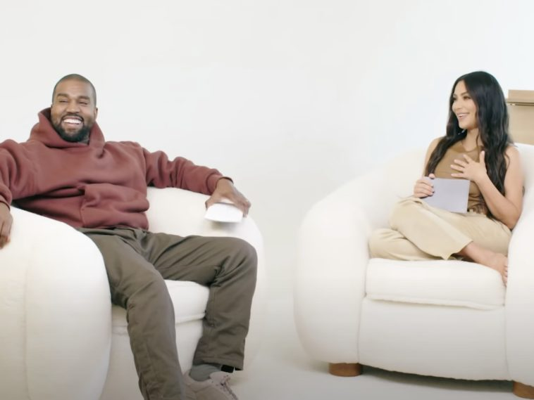 Kanye West and Kim Kardashian sitting together