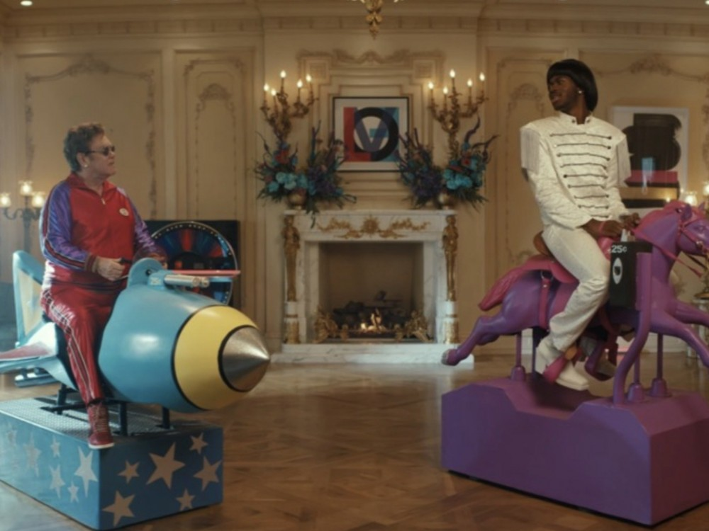 Lil Nas X's Elton John Admiration + Outfit Flexing Finally Explained